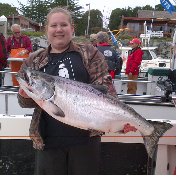 youth girl holding salmon