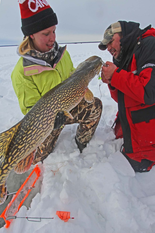youth catching Northern Pike